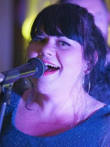 Josie singing happily
